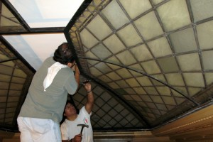 Installing restored stained glass skylight NY Society Library