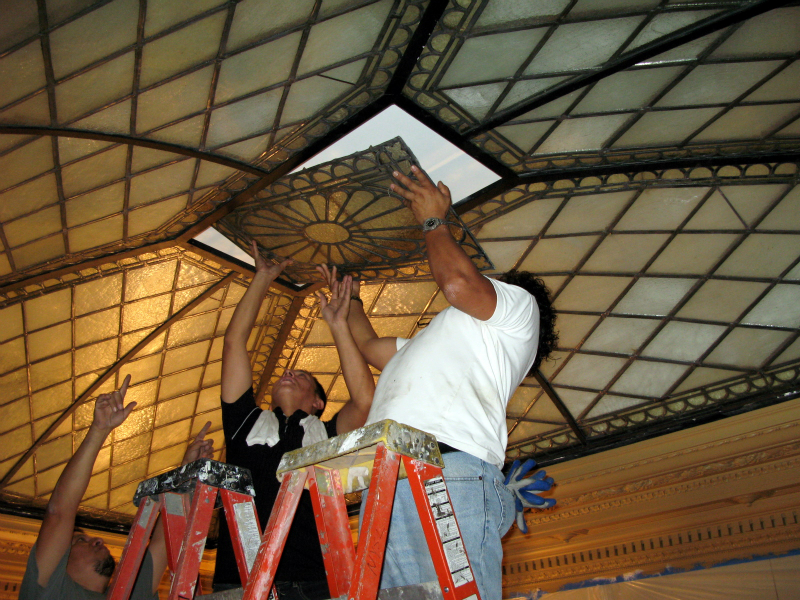 Installing restored central panel stained glass skylight NY Society Library