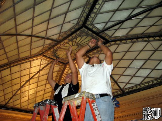 Installing central panel restored stained glass skylight NY Society Library