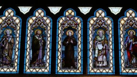 Close up of restored stained glass lancet windows.