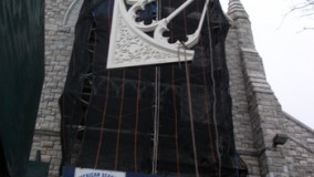 Hoisting Mahogany Window Frame into Position.
