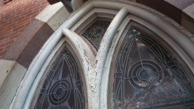 Before stained glass restoration and wood frame replication